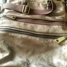 """HPSALE""""FOSSIL"""" EXPLORER LEATHER TOTE.. HOST PICK BEST IN BAGS PARTY ONE HOUR MARKDOWN SALE  FOSSIL AUTHENTIC,EXPLORER LEATHER TOTE  GOLDTONE- BROWNISH LEATHER RICH LUXURIOUSLY LEATHER FEATURES CLASSIC BRASSTONE HARDWARE A COMFORTABLE SHOULDER STRAP & MUTIPLE POCKETS FOR EASY STORAGE; LOGO JACKET RD LINING; LEATHER TRIM CLOSURE ZIPPERED POCKETS,2 SLIPS,2 MEDIUM POCKETS,2 CARD SLOTSINSIDE 2 FRONT ZIPPER POCKETS ON EXTENDER DOUBLE HANDLES, SHOULDER STRAP;14.5L X  1 6H ;22""""SHOULDER DROP, IMPORT…"""