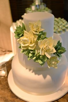 Ganache wedding cake with sculpted roses.