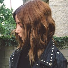 Ashley Tisdale's chestnut shade is the perfect winter hair color.
