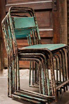 Rusty blue metal chairs