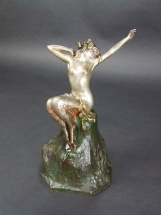 Awakening by Marcel Bouraine Bronze female Satyr with rams horns & goats feet, she is sitting on a bronze rock base. Sculpture Art, Sculptures, Art Deco Artists, Feminine Mystique, Art Deco Era, Fantasy Creatures, Awakening, Chiparus, Sculpture