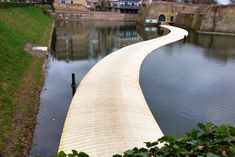Floating Wooden Bridge Lets You Walk on Water to a Centenary Fortress in the Netherlands | Inhabitat - Green Design, Innovation, Architecture, Green Building