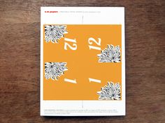 Printable table number. Editable, just enter the number, print and cut. Orange with a black and white dahlia image.