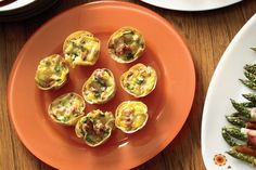 """Asparagus & prosciutto quiches, like the idea of using flat bread (use biscuit cutter to cut to size) as the """"pastry"""""""