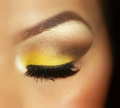 Add this impressive Bright Yellow, Deep Taupe and Bronze ombré to your eye make-up and complete your Easter 2014 look with a stylish pop of colour!