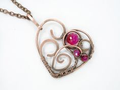 Wire wrapped pendant made of natural stone Agate and mother of pearl and copper wire  Handmade necklace brings mystery and beauty in one.