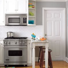 Small-Space Kitchen with VIking Range and Microwave. Another example of how to make a peninsula work in a tiny kitchen.