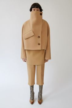 Chessa Boiled camel   Acne Studios Chessa Boiled camel is a double breasted, short cocoon coat with an exaggerated '80s funnel neck.   #PAW17