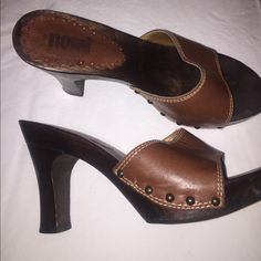 Brown Solid Wood Nomi size 7. Worn once. size 7 solid wood slide on heels. Brown leather. Excellent condition. Love them just never get to wear them.  Brought them from Journeys. Nomi Shoes Heels