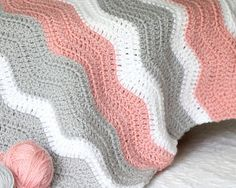 This Peppy Pink Baby Blanket Crochet Pattern is perfect for any little girl! You can never go wrong with a classic crochet chevron pattern. | AllFreeCrochetAfghanPatterns.com
