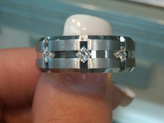 My husband's wedding band from ShaneCo.  He loves how the kite set diamonds match my engagement ring.
