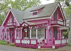 pink house with detail to the white trim