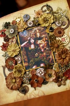 Steampunk Debutante creation by Beth Arp.  I love the way she used flowers and other objects to surround the image...definitely want to try something similar on a future piece.
