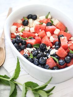 Red White and Blue Fruit Salad: watermelon, jicama, feta cheese and blueberries tossed in a sauce of lime juice, honey, chili powder, salt, and mint