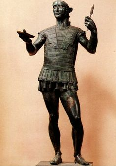 Mars of Todi, a near life-size bronze of a warrior (found without his helmet), making an offering to the gods before a battle. It is an extremely rare and well-preserved example of Etruscan statuary art, and dates to the end of the 5th century BCE. It was found in the Umbrian town of Todi in 1853 buried between four slabs of travertine.