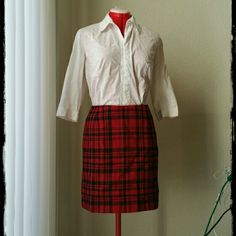 "Vintage Red Plaid Skirt Vintage, 65% wool 35% rayon blend plaid skirt by Eddie Bauer is fully lined.  Vtg. size 4 petite measures: waist 27"",  width of hem 39"",  length 18"" falls above the knee.  Pair it with a sweater and boots for a great old-school look. Vintage Skirts Pencil"