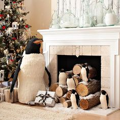 Decorate with Penguins Use an old fireplace to create this penguin focal point. Stack logs sprinkled with artificial snow in the fireplace opening and dot with penguins.