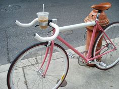 Pink fixie with awesome latte holder (minus the lame Steelers emblem)