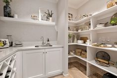 Butler's pantry in the Classic Hamptons interior style by World of Style