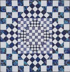 Lovely graphic blue and white quilt idea