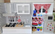 DIY cardboard play kitchen - I could totally do this with all the Amazon boxes we get.