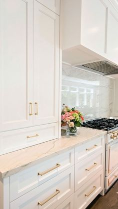 stone countertop and slab backsplash with white cabinets