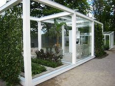 Pergola with garden beds & glass doors for seating