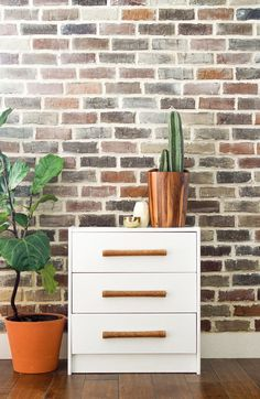 The IKEA Rast dresser ($35) is supremely basic—the ideal canvas for a style upgrade. Leather-wrapped dowels make for craftsman-chic drawer pulls. Visit Vintage Revivals for this IKEA Rast hack.