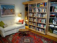The bookshelf slide aside, revealing a murphy bed, fully made, ready to pull down...perfect!     Do You Really Need More Than 260 Square Feet? - NYTimes.com