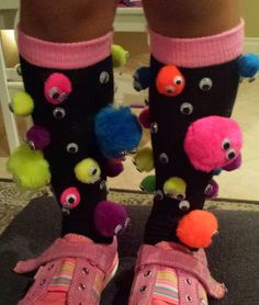 Google eyes and Pom poms glued using E6000. Perfect for crazy sock day!