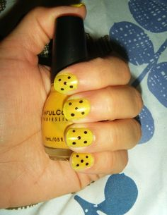 My Yellow Polka-Dot Mani. This is Rise and Shine by Sinful colors and just used a dotting tool for the black dots using a black stripe rite polish. Seche Vite my top coat of choice :)