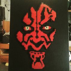 Darth Maul from Star Wars fame. Made in perler beads on a 16x20 inch canvas.
