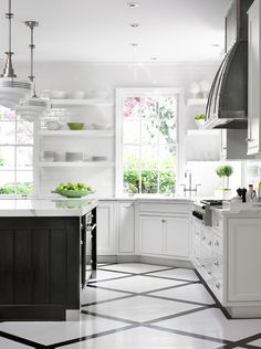 Kitchen. White kitchen with dark island. Kitchen Painted Floors. Kitchen Schoolhouse Pendants. Zinc Kitchen Hood. Kitchen Open Shelves. Kitchen Corner Sink. Beth Webb Interiors.
