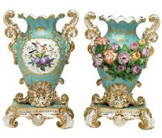 A PAIR OF JACOB PETIT PORCELAIN SKY-BLUE GROUND FLOWER-ENCRUSTED TWO-HANDLED VASES ON FIXED STANDS