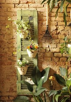 When I get my corner wall built around the fire pit, I am so doing this.  Repurposed shutter.