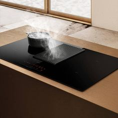 The NikolaTesla has a variety of functions such as touch controls and 9 power levels. Finished in black glass with a cast iron grille, this fabulous hob will look great in your new kitchen and more importantly improve the air quality. Kitchen Hob, New Kitchen, Open Plan Kitchen Living Room, Extractor Fans, Electric Cooker, Electrical Connection, Cooker Hoods, Tiny Living, Black Glass