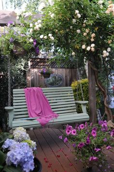 Petunias, clematis, hydrangeas and roses... a swing and a magazine... a cool drink and all is right with the world.