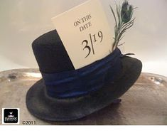 Amazing Alice in Wonderland Invitation tucked into the hat band of a Mad Hatter's Hat by Swank Productions!    #wonderland