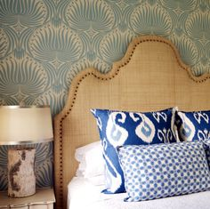 Love the headboard & pillows. Like the wallpaper, but what's up with that lamp!