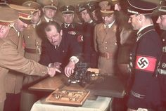 See more HERE: https://www.sunfrog.com/trust-me-im-an-engineer-NEW-DESIGN-2016-Black-Guys.html?53507 Ferdinand Porsche, the famed automobile designer, presents Adolf Hitler with the model of a tractor on the occasion of Hitler's 50th birthday in April 1939. Hitler's birthday was always an opportunity for grand celebrations, at least during the years preceding the war.