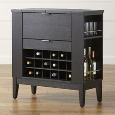 Shop Parker Spirits Ebony Cabinet.   Crafted of solid birch and ash and ash veneer, the bar has a rich ebony finish.  Finished on all sides, even the back, Parker can be positioned anywhere in the room.