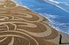 """NEW BRIGHTON: Peter Donnelly etched hundreds of works into the volcanic New Brighton sands using rakes and sticks. """"At the end of the four hours, it wants to go, it's worn out. It's gifted to the sea. New Brighton Beach, New Zealand Art, Sand Sculptures, Kiwiana, Aerial Arts, Grain Of Sand, Sand Art, Patterns In Nature, Outdoor Art"""