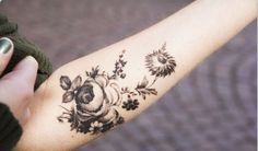 Gorgeous little black n white floral tattoo