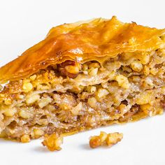 A classic baklava recipe drizzled with syrup for a sweet and satisfying treat.