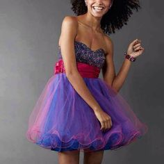 Pink purple sparkly dress Juniors size 11. Worn once, has been sitting in a plastic bag ever since. Puffy skirt. Layers of structured tulle. Sequin filled top. Strapless. Perfect for prom. Speechless Dresses