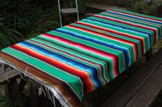I want to recover one of my ottomans in Mexican blanket material...  Any crafty helpers out there?  How can I make it look neat?