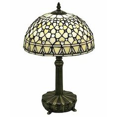 This 19 in. White Jewel 1 Light Table Lamp will add flare of elegance to your home or office with this stunning white jewel lamp. It features Tiffany-style stained glass and cast-metal base in bronze finish. The One standard bulb provides ill Tiffany White, Tiffany Glass, Brown Table Lamps, Buffet Lamps, Tiffany Style Table Lamps, Tall Lamps, Lamps For Sale, Desk Light, Light Table