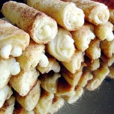 Cheese Blintzes [loaf of white bread, cream cheese, sour cream, sugar, cinnamon, milk, butter and milk] Can be made ahead and frozen, fabulous!.