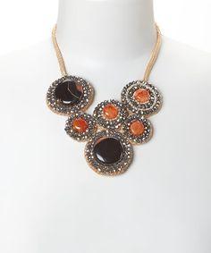 Love this Orange & Smokey Crystal Six-Disc Bib Necklace by PANNEE JEWELRY on #zulily! #zulilyfinds