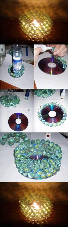 Beautiful candle holder using a cd and some old marbles. Great reuse after the kids out grow playing with these things.